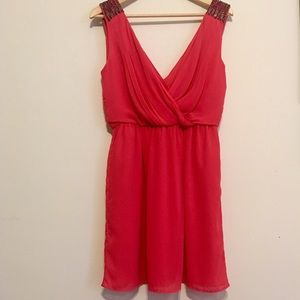 Short light red dress with beaded shoulders